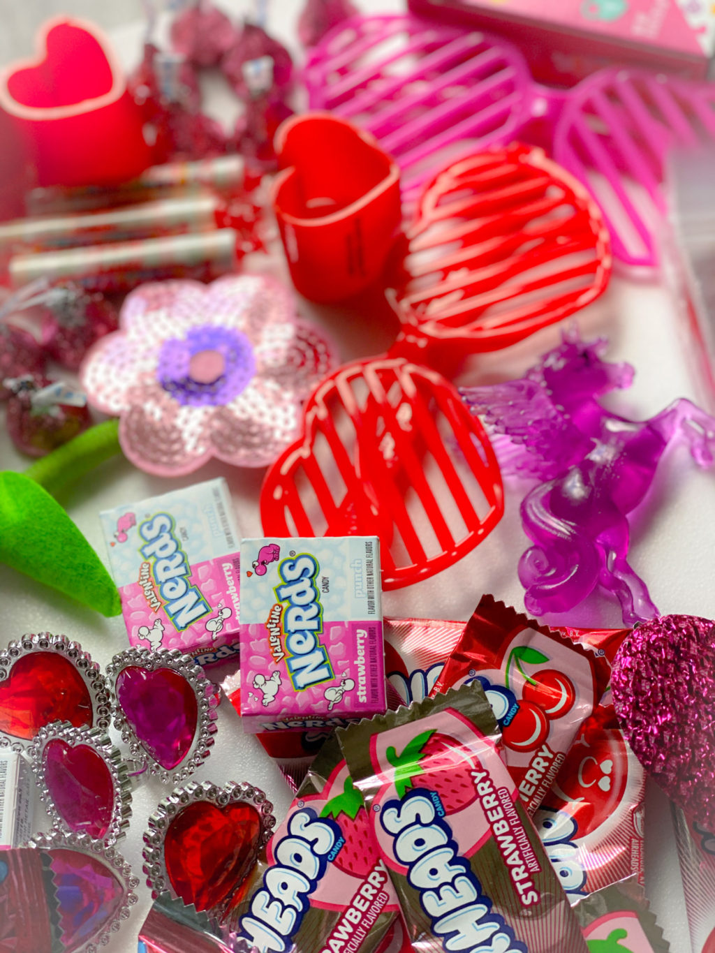 dollar tree valentine's day treats like heart sunglasses, heart rings and pink and red candy