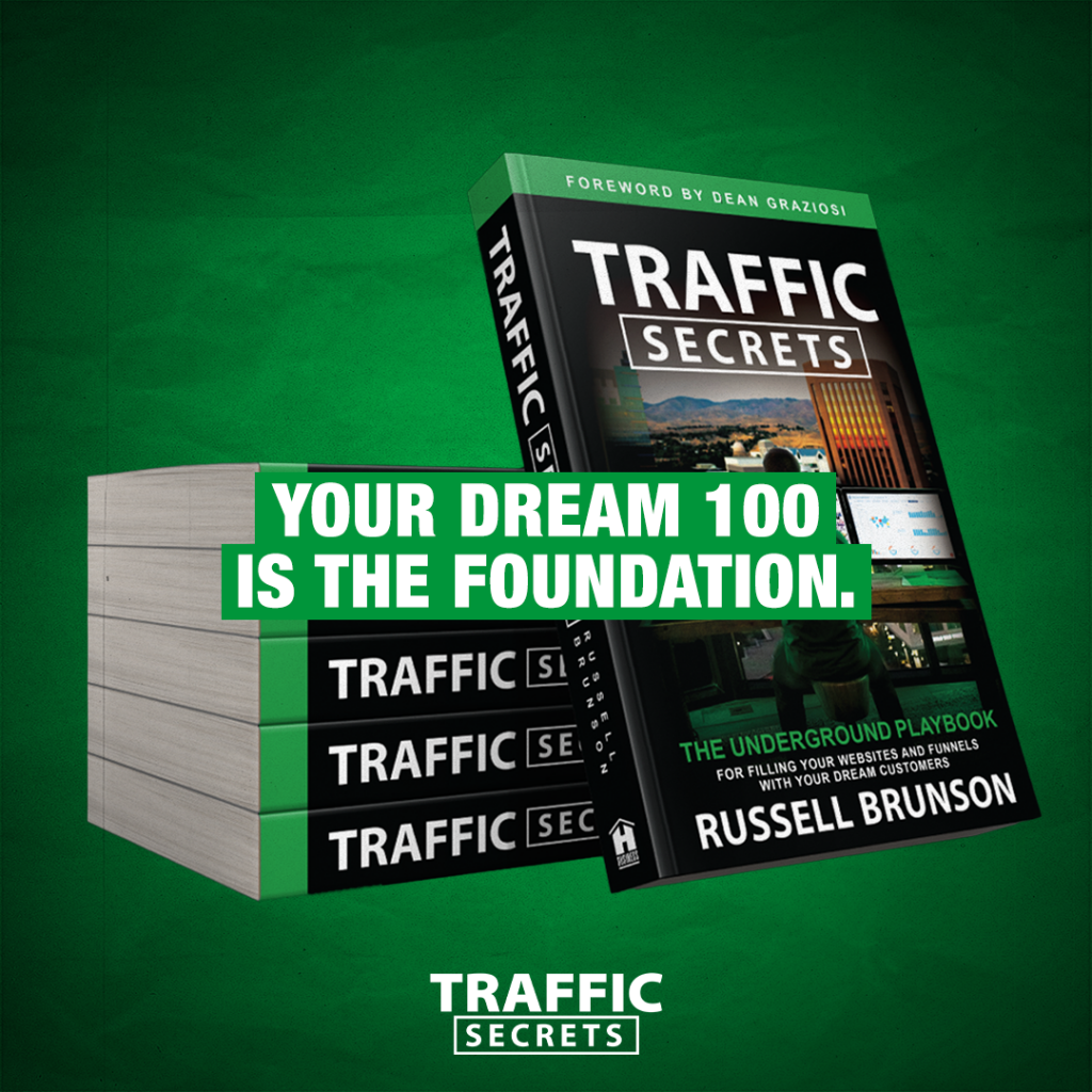 stack of traffic secret books on green background